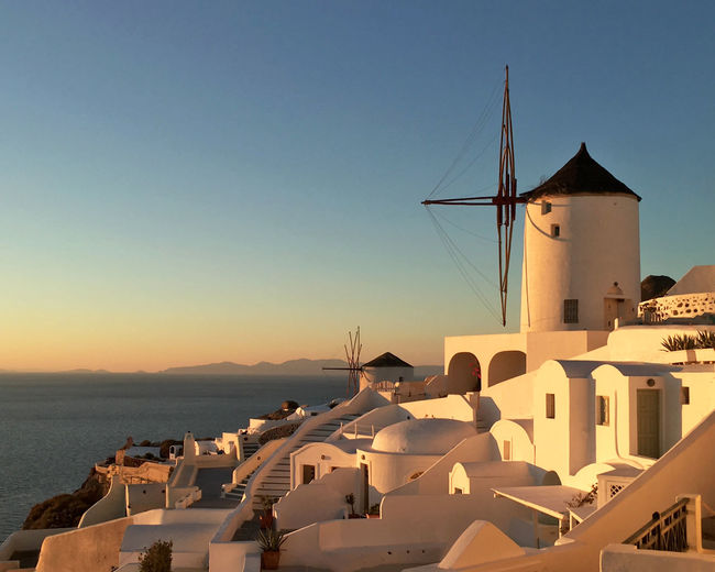 Santorini - Evening light in Oia Architecture Atmospheric Light Atmospheric Mood Atmospheric Scene Clear Sky Evening Evening Light Mediterranean  Mediterranean Sea No People Outdoors Romantic Romantic Place Sunset Traditional Windmill Travel Destinations Water Wind Power Windmill