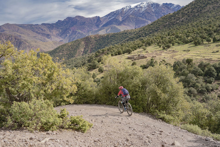 Bicycle Mountain Sport Riding Activity One Person Leisure Activity Ride Cycling Environment Outdoors Mountain Range Mountain Bike Mountain Biker Mountain Biking Woman Athlete Female Speed Fast Valley Expanse Vista Ridgeline Trail