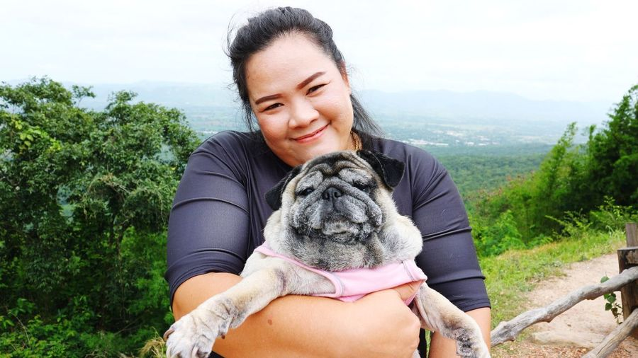 pug dog Tree Women Sitting Pets Beach Young Women Smiling Sky Close-up Single Parent Posing Hiker Abdomen Pregnant Prenatal Care Maternity Wear Human Abdomen New Life Belly Button Newborn Weight Sepal Stomach Hope Hands On Stomach Bud Waist Human Fertility Abdominal Muscle Beginnings