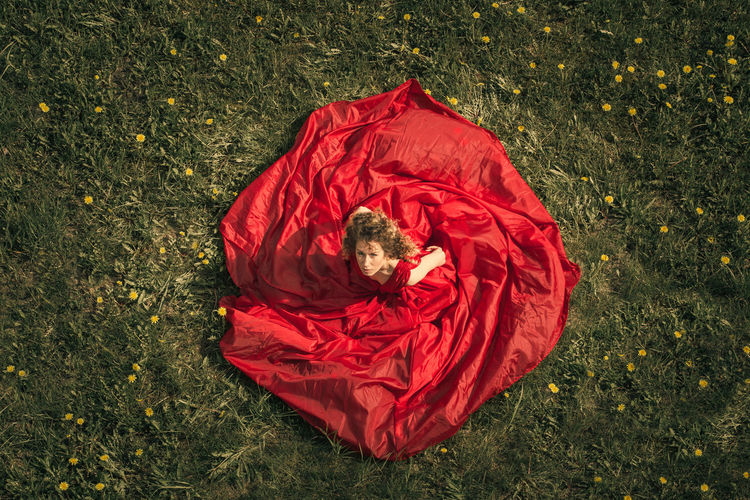 High angle view of person lying on field