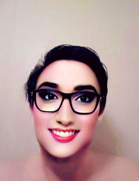 The other me, glowing in the A.M. Smile Gray Background Hairstyle Alluring  Breathtaking EyeEm Selects Mature Adult Self Portrait Faceapp Male To Female Drag Posing Lifestyles Portrait Beautiful Woman Young Women Eyeglasses  Smiling Beauty Beautiful People Looking At Camera Headshot Red Lipstick Eyeliner Mascara Eyeshadow Lip Gloss Eye Make-up Lipstick Blush - Make-up