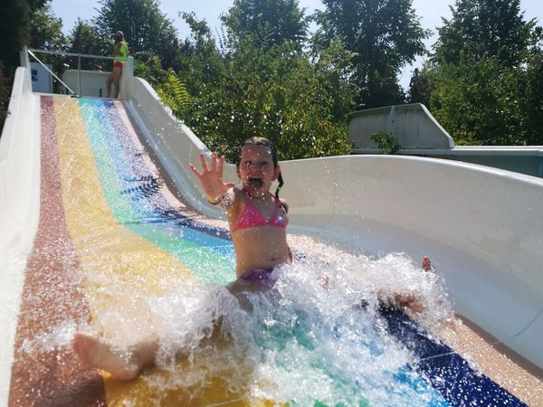 Little Girl Fun Water Slide Rainbow Water Slide Water Spraying Swimming Pool Tree Childhood Happiness Water Park Playing