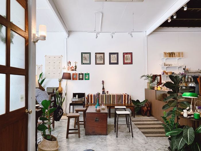 Interior of cool cafe Decoration Decor Plant Lifestyle Indoor Workspace Style Retro Vintage Coffee Shop Interior Cafe Cool Seat Chair Table Indoors  Architecture Furniture No People Built Structure Day Wall - Building Feature Window Building Lighting Equipment Ceiling Entrance Setting Door