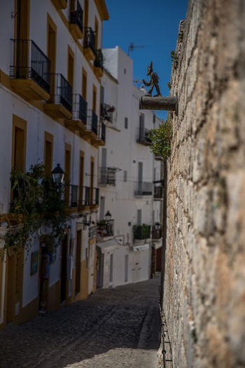 Alley Architecture Belief Building Building Exterior Built Structure City Dalt Vila Day Ibiza City Low Angle View Nature No People Outdoors Place Of Worship Religion Residential District Selective Focus Sky Spirituality Wall Wall - Building Feature Historic Fortified Wall Castle Old Town Fort Fortress
