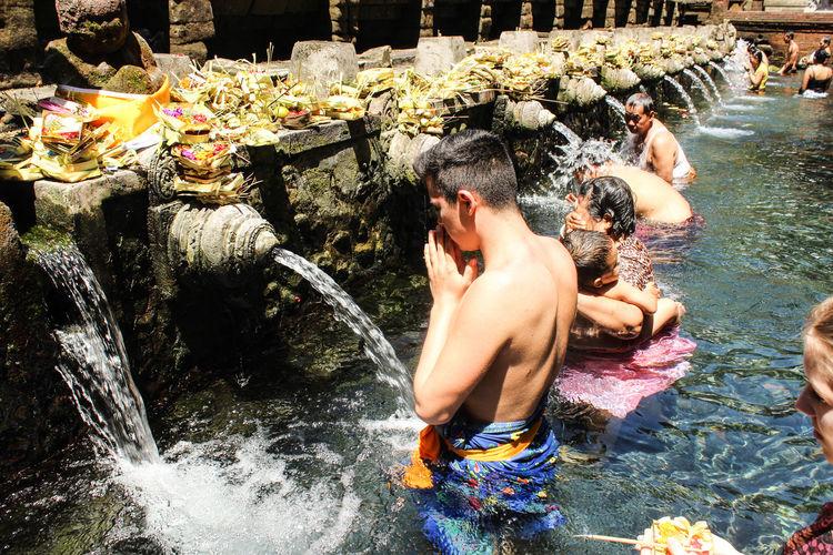 People Bathing In Holy Water Of Tirta Empul Temple