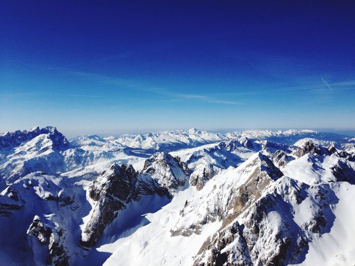 Scenic view of snow covered mountains