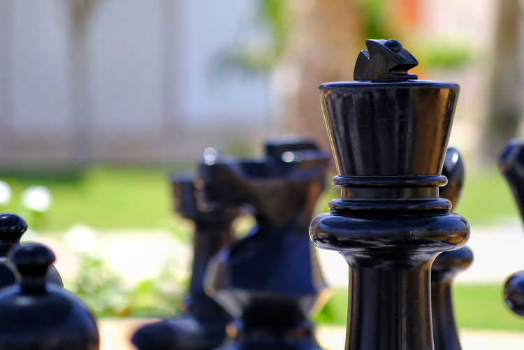 Close-up of chess piece outdoors
