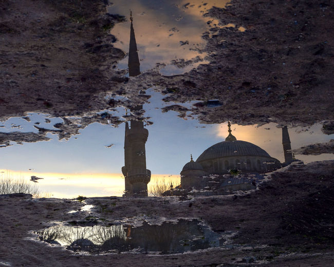 Upside Down Image Of Sultan Ahmed Mosque Reflection In Puddle