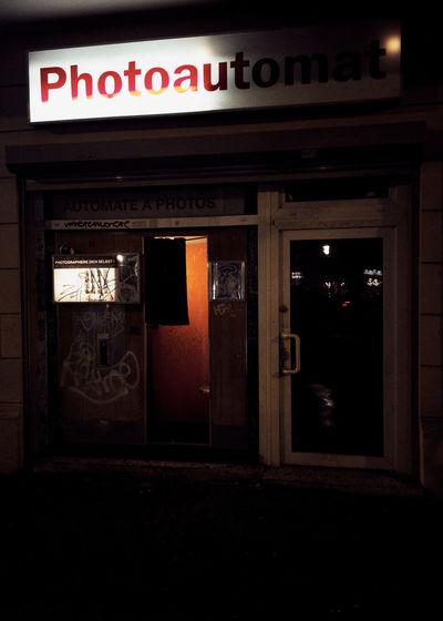 Illuminated text on red door at night