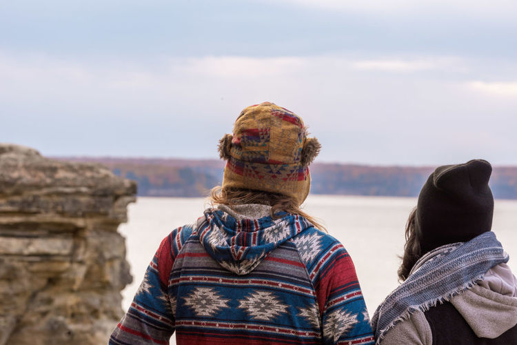Rear view of man and woman looking at view