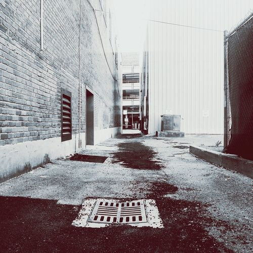 Walkway by buildings in city
