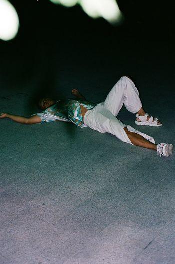 High angle view of people lying on floor