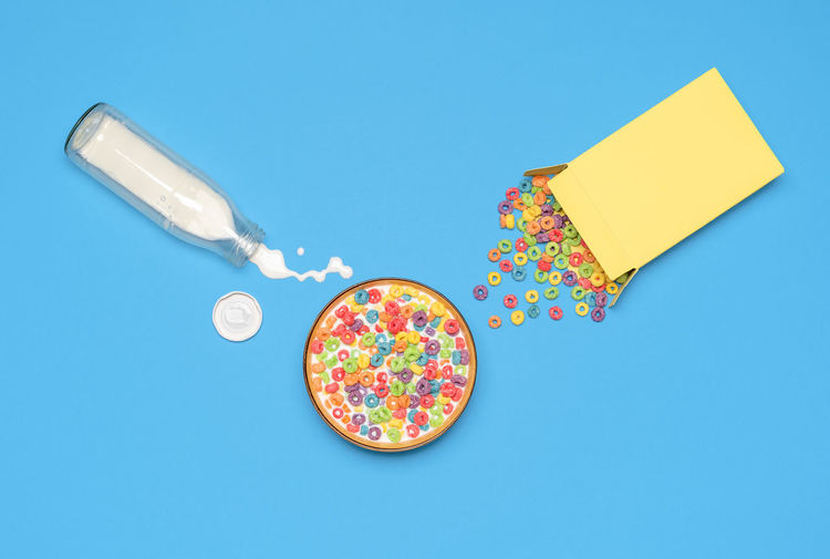 High angle view of candies against blue background