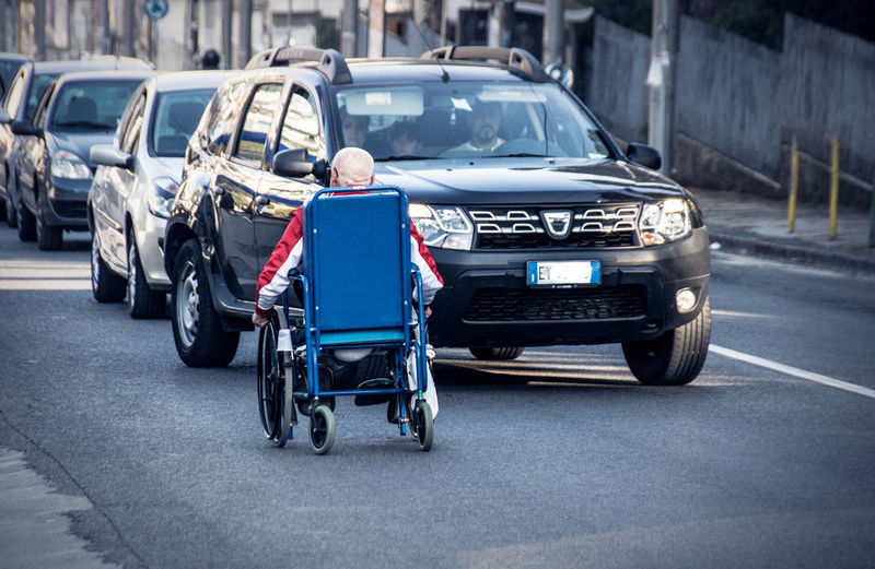 Italy❤️ Italian City Streetphotography Street Transportation Mode Of Transportation Car Motor Vehicle Road Land Vehicle City One Person Real People Day Rear View Full Length Motion Sign Travel Blue Outdoors Wheelchair on the move Wheel Handicap Handicapped Non-ambulant Person Motor Deficiency Senior Adult Old Person Mobility Problems The Art Of Street Photography
