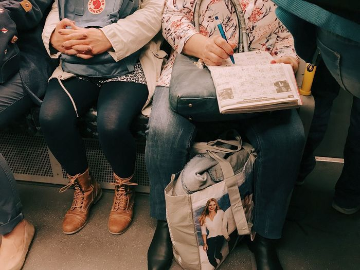 Low section of people sitting on floor