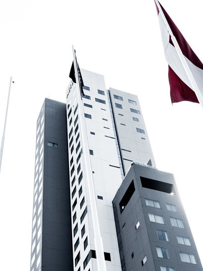 High rise building Architecture Building Exterior Built Structure City Clear Sky Day Flag High Rise Building Low Angle View No People Outdoors Patriotism Sky The Architect - 2017 EyeEm Awards
