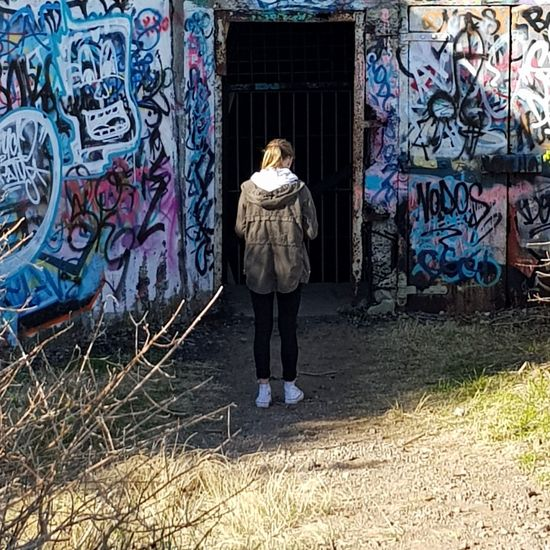 Exploring EyeEm Selects Exploring Full Length Standing Rear View Graffiti Street Art Architecture Spray Paint ArtWork Colorful Spray Bottle Art