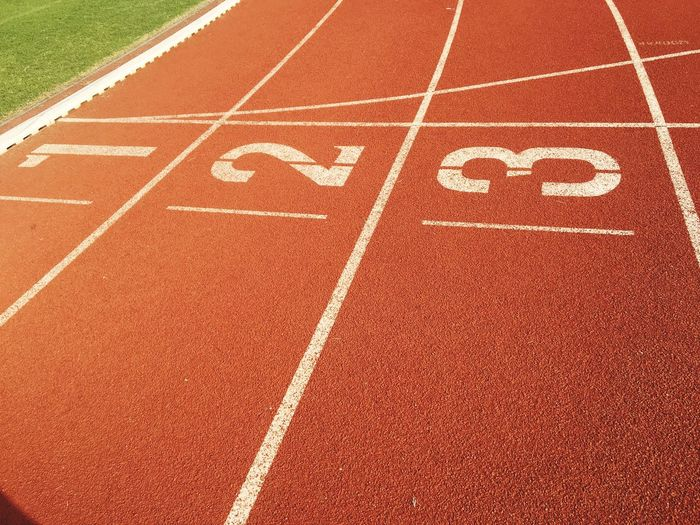 High angle view of numbers on running track