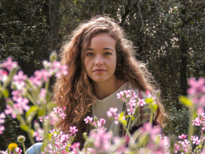 Emotional Photography Pink Beautiful Woman Beutiful  Brown Hair Contemplation Emotional Flower Flowering Plant Flowers Focus Front View Hair Hairstyle Headshot Long Hair Looking At Camera Nature One Person Outdoors Plant Portrait Purple Strong Look Women Inner Power EyeEmNewHere Summer Exploratorium