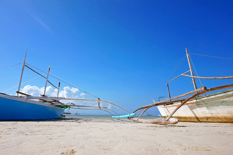 Anchored Boats Beach Boats Beauty In Nature Blue Clear Sky Day Eyeem Philippines Fishing Boats Nature No People Outdoors Sky Sunny The Great Outdoors - 2016 EyeEm Awards The Week On EyeEm Tranquil Scene Tranquility White Sand Beach My Commute
