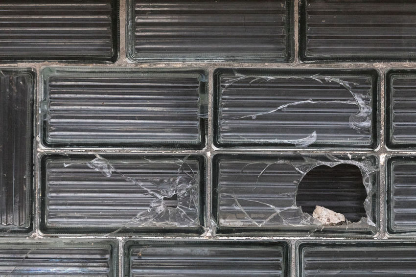 Hole in glass brick shattered by a stone Aggression  Backgrounds Broken Building Exterior Built Structure Close-up Cracked Damaged Day Destruction Full Frame Glass - Material Glass Brick Hole Misfortune No People Old Outdoors Pattern Rectangle Shattered Glass Social Issues Stone - Object Wall - Building Feature Window