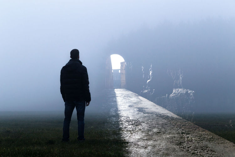 Contemplation Futuristic Adult Cold Temperature Fog Nature One Person Outdoors People Rear View Reflect See Light At The End Of The Tunnel Silhouette Standing Stare Into The Distance Weather Winter