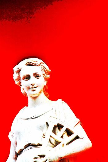 Art Art And Craft Color Enhanced Creativity Goddess Of Wisdom Human Representation Idol Large Man Made Object Red Red Background Religion Sculpture Sextant Spirituality Statue Studio Shot The Color Of School Vibrant Color