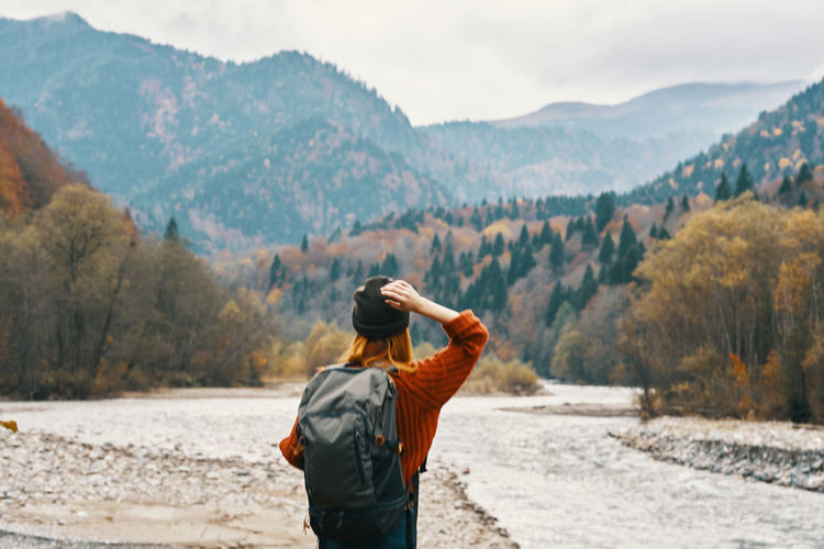 Rear view of man looking at mountains