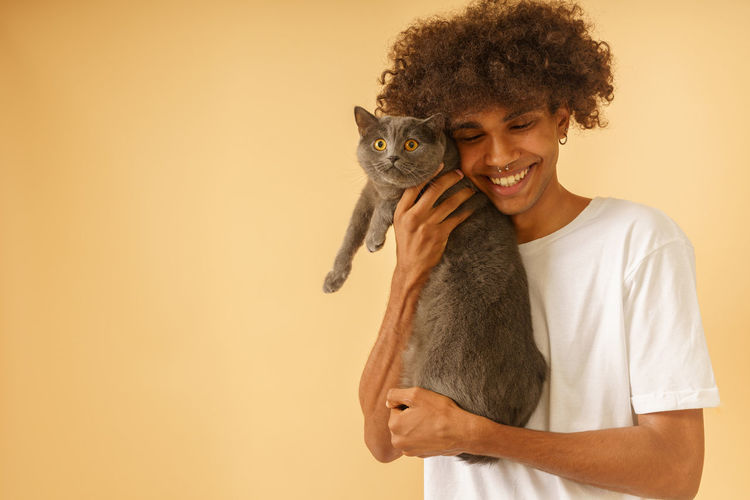 Portrait of smiling young woman holding cat