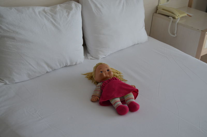 High angle view of doll on bed