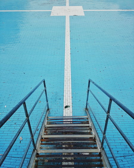 Railing Day Sea Steps Staircase Water No People Outdoors Beach Blue Close-up