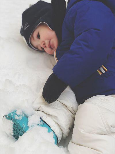 Cute boy lying on snow