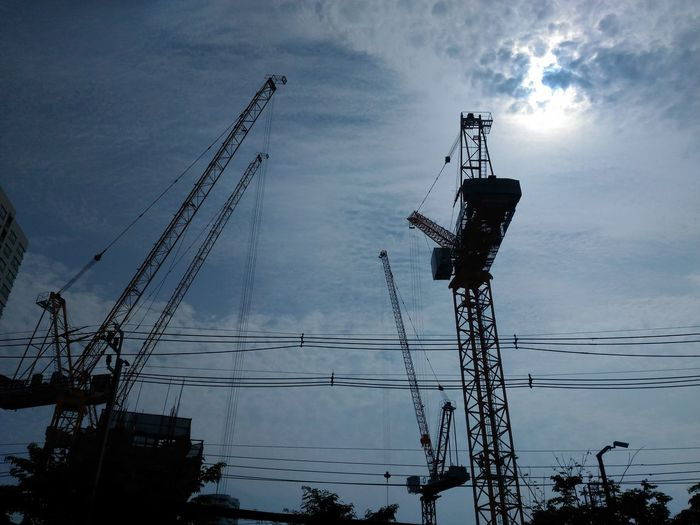 Silhouette Outdoors Cloud - Sky No People Tower Cranes Construction Site Construction Electricity  Cable Silhouette Sky Day