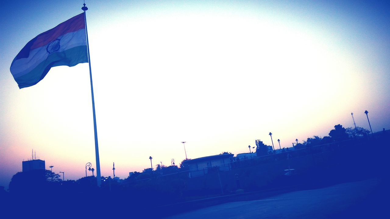 flag, patriotism, outdoors, pride, low angle view, clear sky, no people, sky, sunset, architecture, day, city