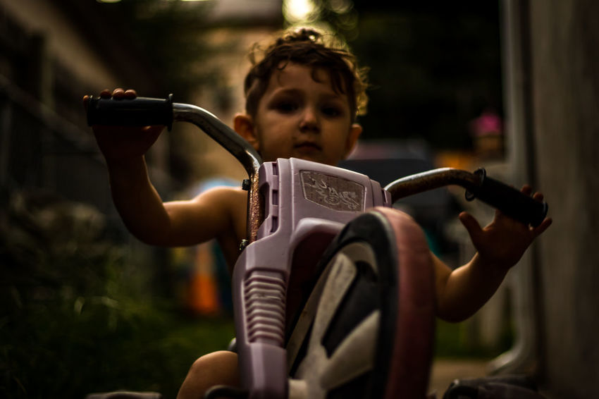 This is a shot of my three year old on his favorite big wheel riding up and down the sidewalk. Arts Culture And Entertainment Big Wheel Bike Camera - Photographic Equipment Casual Clothing Communication EyeEm Gallery Focus On Foreground Hobbies Holding Leisure Activity Person Photographing Photography Photography Themes SLR Camera Son Technology This Week On Eyeem