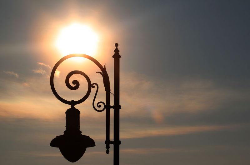 Silhouette Street Light At Sunset