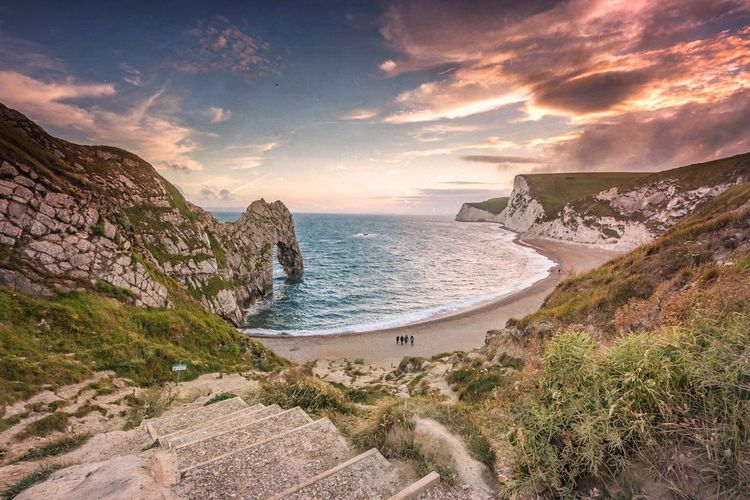 Scenic View Of Durdle Door During Sunset