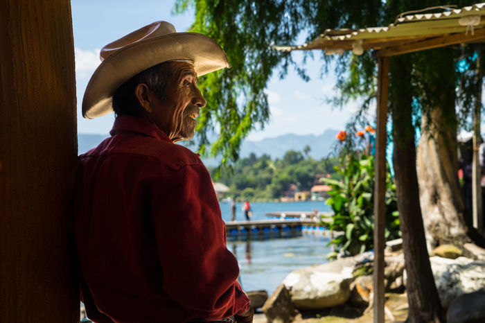 Atitlan Lake Guatemala Guatemalan  Asian Style Conical Hat Atitlan Casual Clothing Day Focus On Foreground Guate Hat Leisure Activity Lifestyles Men Nature Nautical Vessel One Person Outdoors Portrait Real People Rear View Sky Standing Tree Adventures In The City
