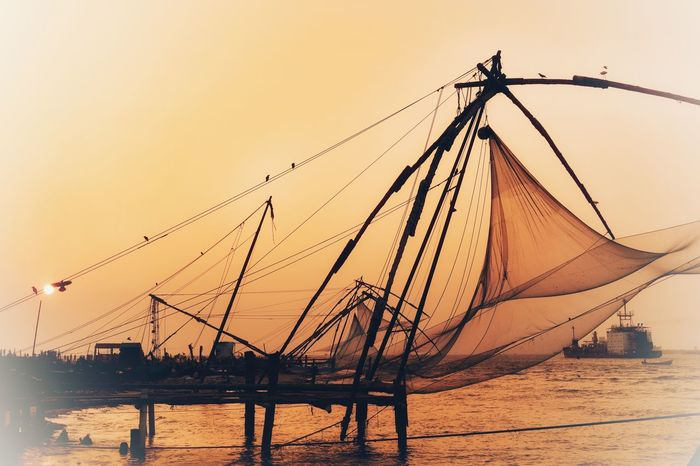Chinese fishing nets in Kerala Kerala Tourism India Kerala Cochin Sea Water Sunset Nautical Vessel Nature Transportation Sky Scenics Beach Outdoors Beauty In Nature Horizon Over Water Tranquility Tranquil Scene No People Clear Sky Mast Day