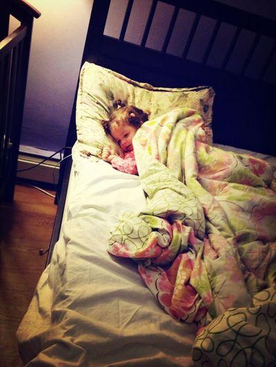 Pretending she's going to sleep !