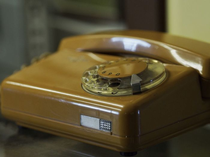 Close-Up Of Rotary Phone On Table