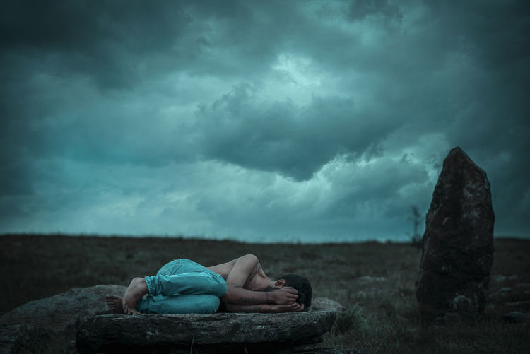 Man sleeping on rock