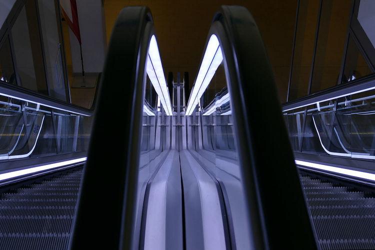High angle view of illuminated escalators in subway station