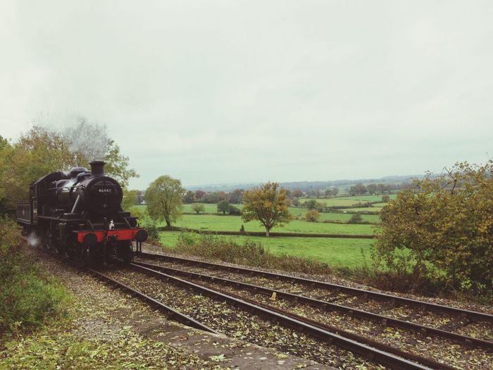 Railroad Track Transportation Nature Mode Of Transport Rail Transportation Tree Sky Steam Train Scenics Day Landscape Outdoors Beauty In Nature Grass No People england Heritage Steam