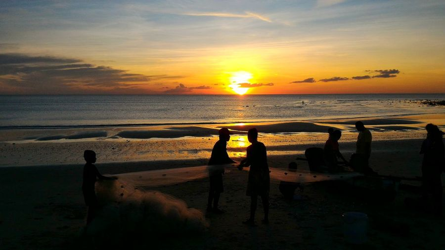 Fishermen, Sunset, and Memories Fishermen Nusatenggaratimur Saburaijua Water Sea Sunset Beach Togetherness Silhouette Sunlight Sun Shadow Seascape Horizon Over Water Calm Ocean
