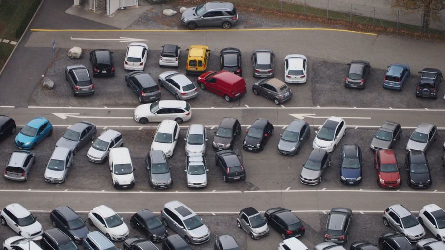Beautifully Organized is all relative. It's not the most beautifully organised car park by Swiss standards, but most of the cars in this picture belong to Italian factory workers, and the Italians have their own special variation of Beautifully Organized. Beautifully Organized Car Day High Angle View No People Parking Parking Lot Road Stationary Street Transportation