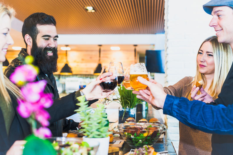 Friends Toasting Wineglass At Table In Bar