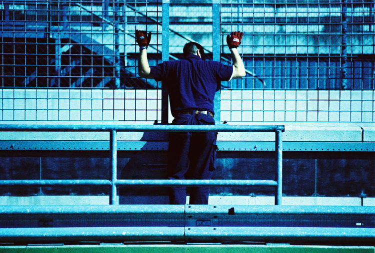 Architecture Casual Clothing Hands Up Leisure Activity Man Pit Lane Racetrack Waiting