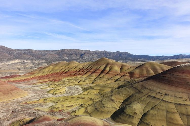 The Painted Hills of Oregon Formation Arid Climate Outdoors Remote Physical Geography Geology Land No People Cloud - Sky Idyllic Day Nature Tranquility Mountain Environment Tranquil Scene Beauty In Nature Non-urban Scene Sky Landscape Scenics - Nature Painted Hills John Day Fossil Beds National Monument Oregon