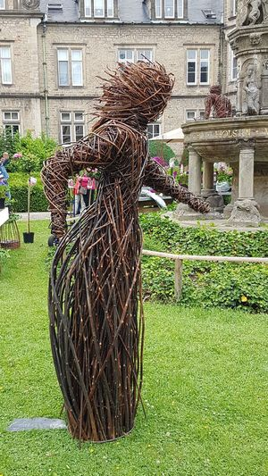 Statue Made Of Willow Rod Standing Architecture Building Exterior Built Structure Outdoors Day Growth Grass No People Nature Garden Photography Outdoor Photography Garden Decoration Handmade